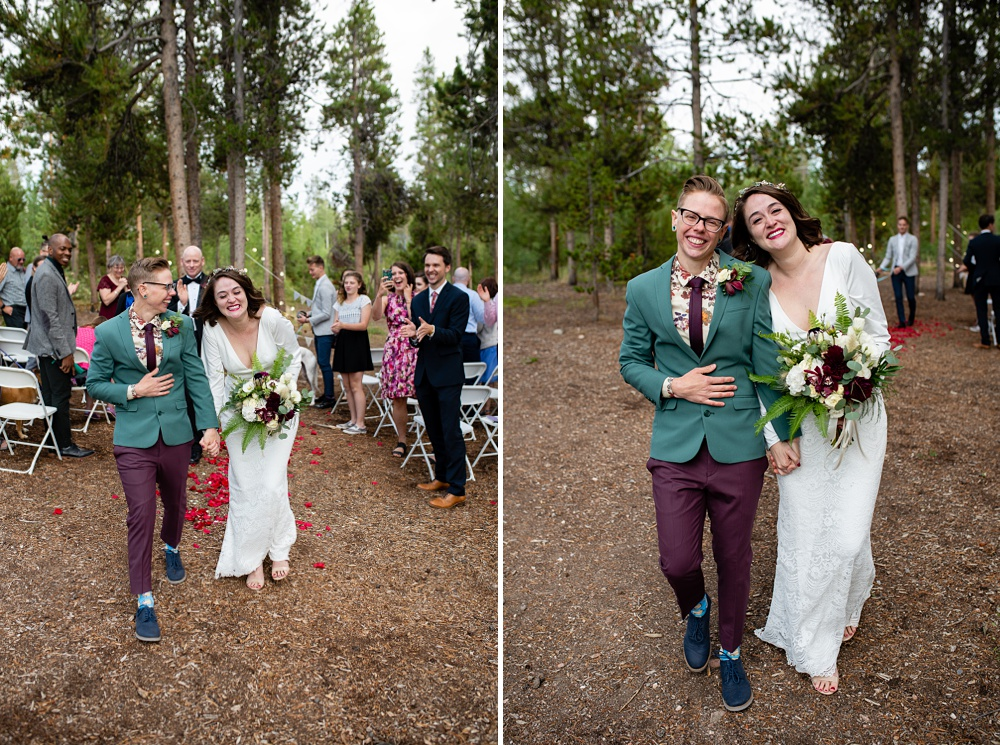 dapper lesbian couple walking down the aisle after getting married at their Colorado lgbtq wedding
