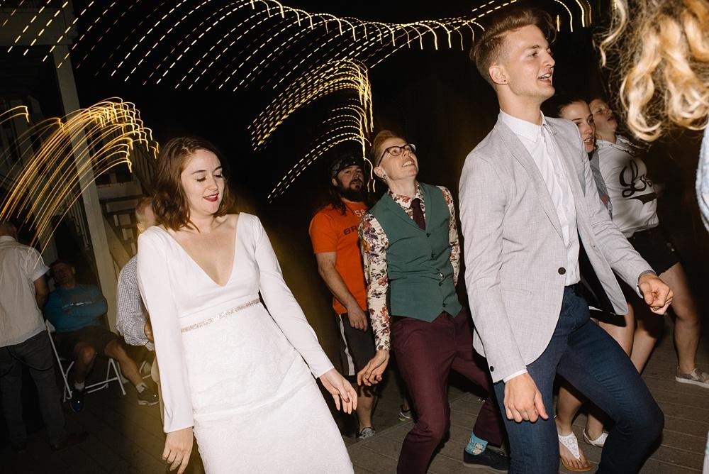 two brides get down at their Colorado wedding reception