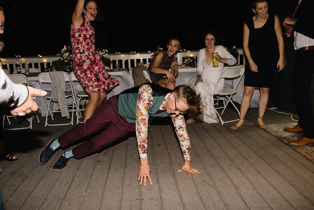dapper bride getting down at at her Colorado wedding reception
