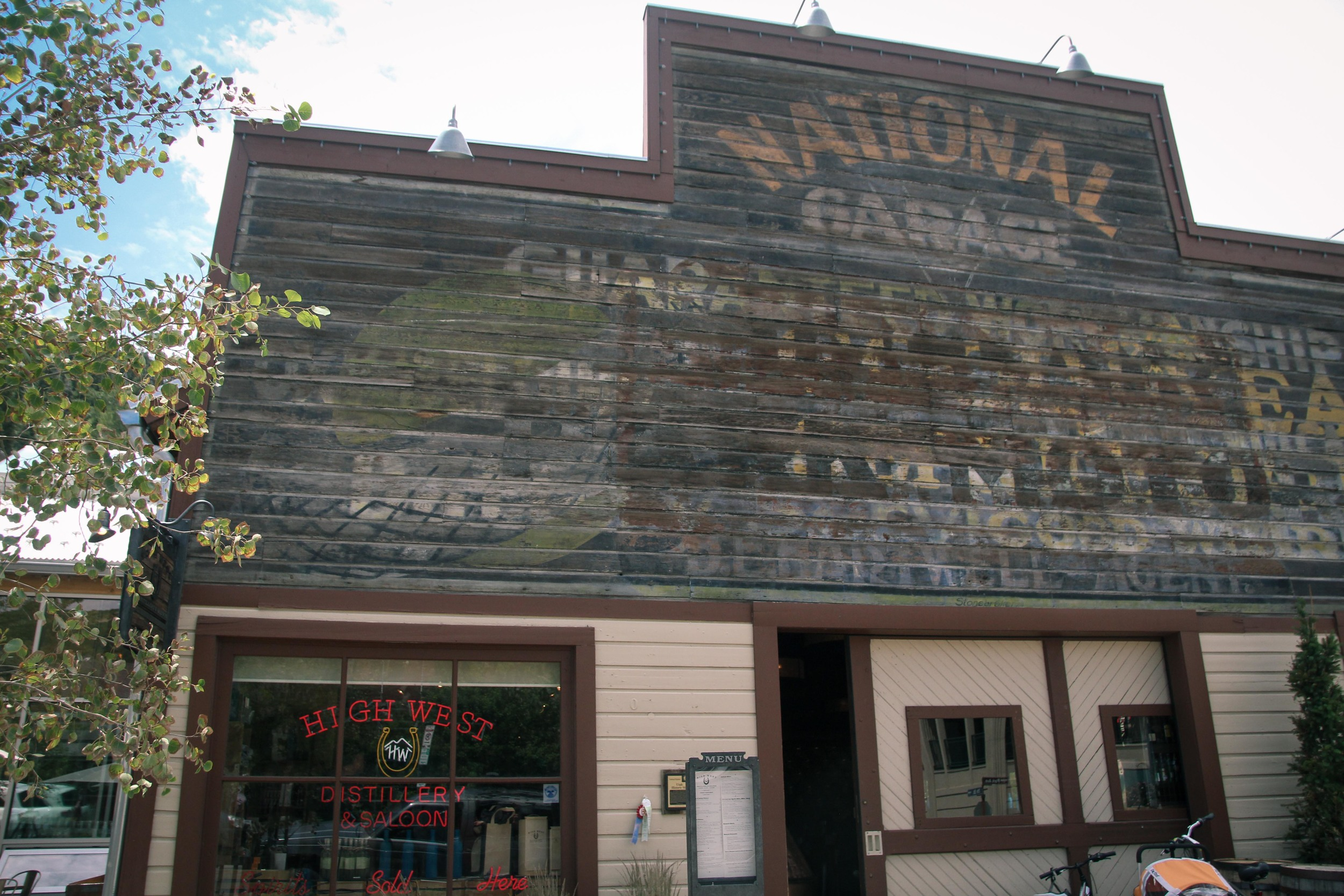 A fire across the street melted away the outer paint on this building, revealing historical layers of signage underneath.