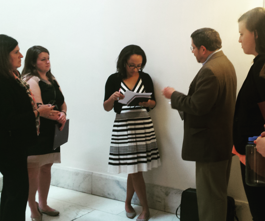 Greg Smith and others talk with an aide to Sen. Mark Warner (D-VA) about proposed legislation that affects immigrants