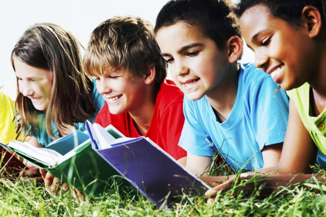 Young kids reading in grass.jpg