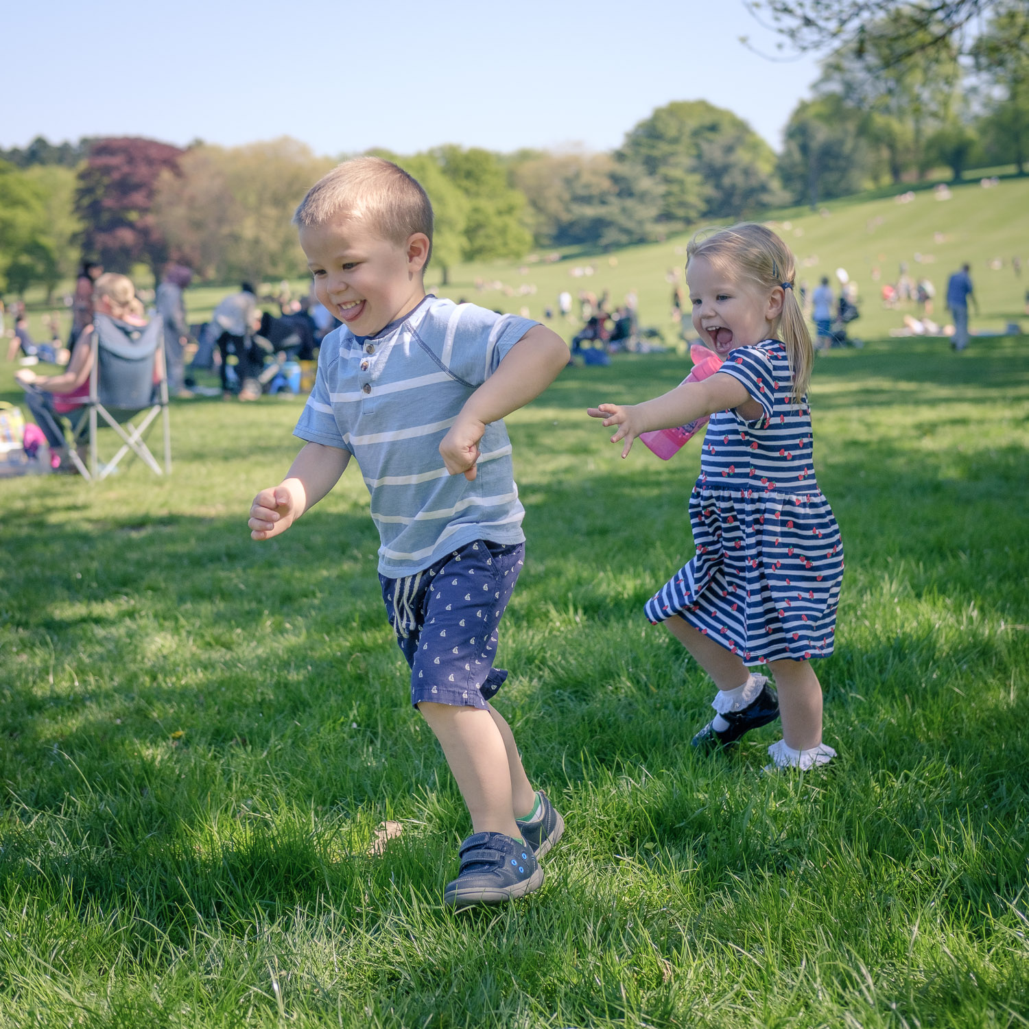 Brother and sister playing chase at Wollaton Park, Nottingham