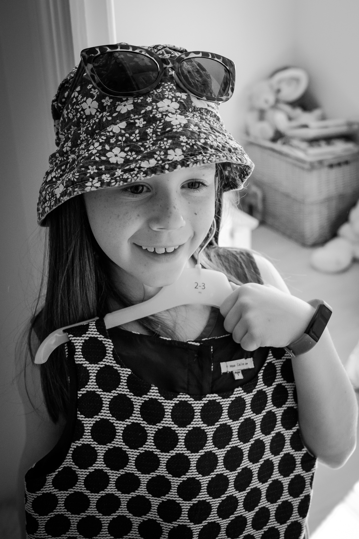 Daughter dressing up during family photography at home in black and white