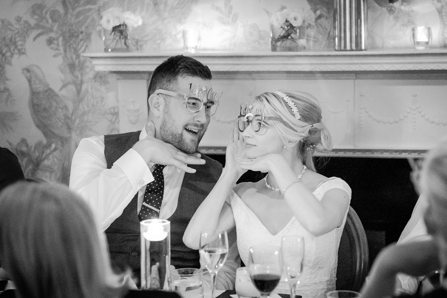 Documenting Rachel and Liam's intimate wedding at Nottingham's World Service Restaurant, bride and groom having fun with wedding glasses