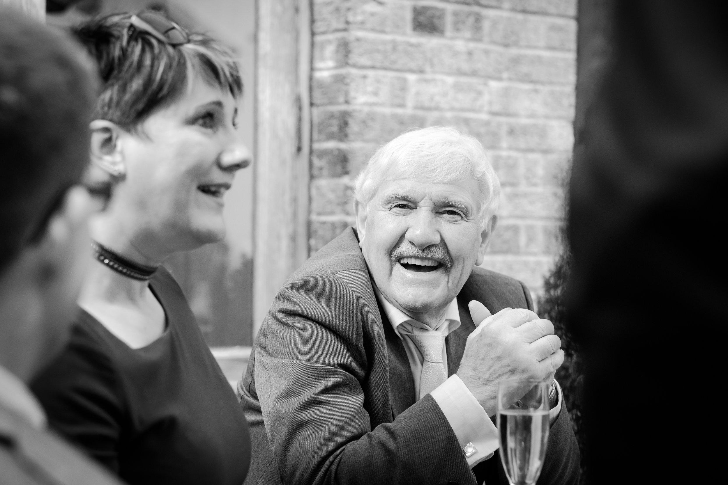 Grandad laughing at granddaughters wedding