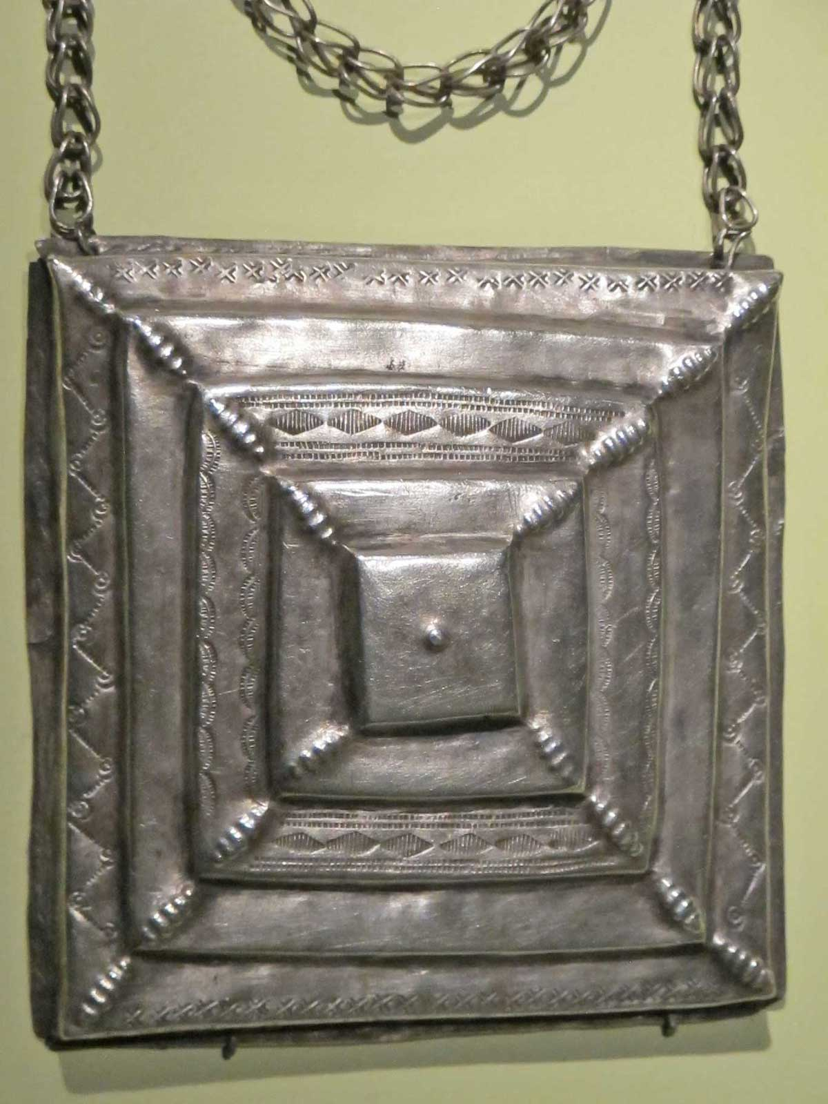 Square pendant by Mende artist from Sierra Leone, of silver, early 20th century.