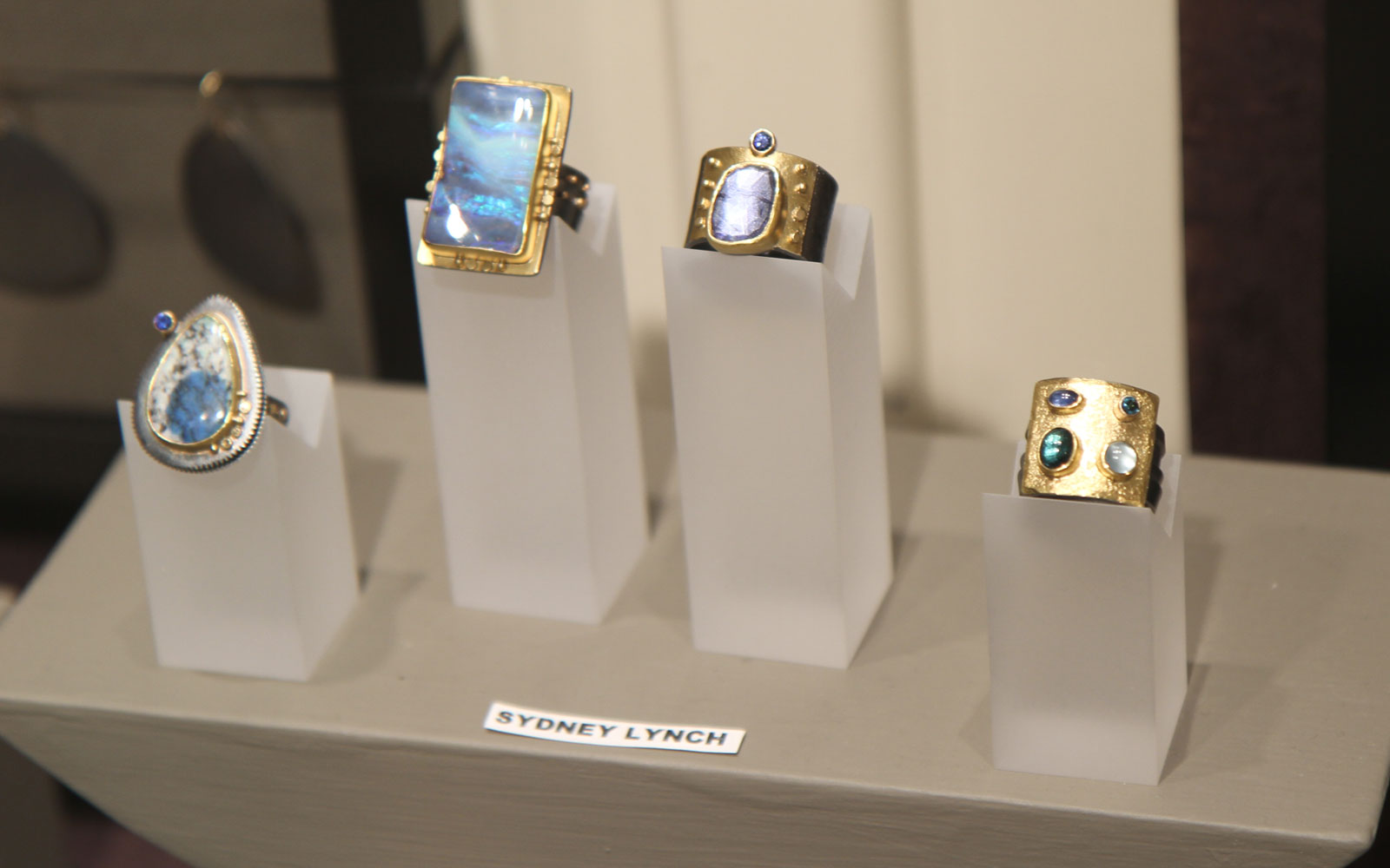 Sydney Lynch's artistically arranged rings, using silver, gold, opals and other assorted semi-precious gems.
