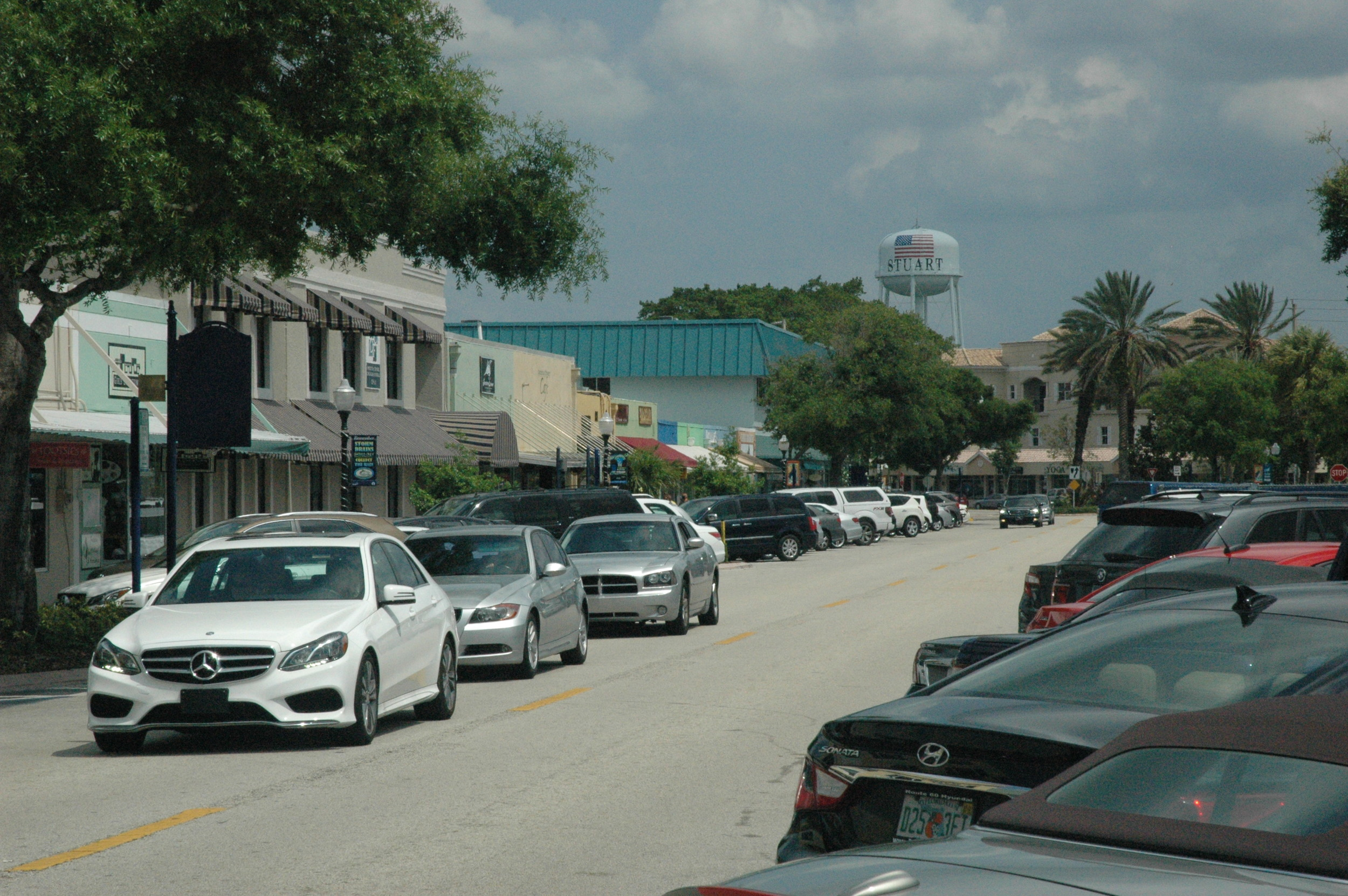 Cars hunting for parking spaces in Stuart, Florida.