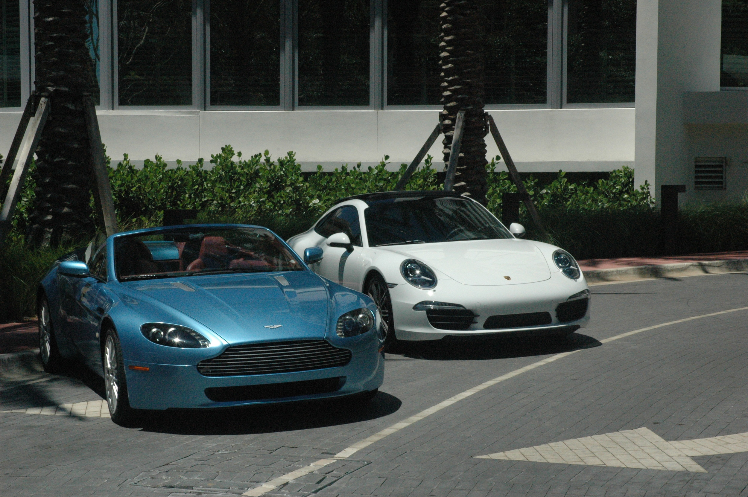 Aston Martin and a Porsche, outside a Miami Beach hotel.
