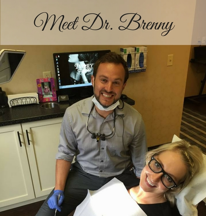 Dr. Brenny helping a dental patient