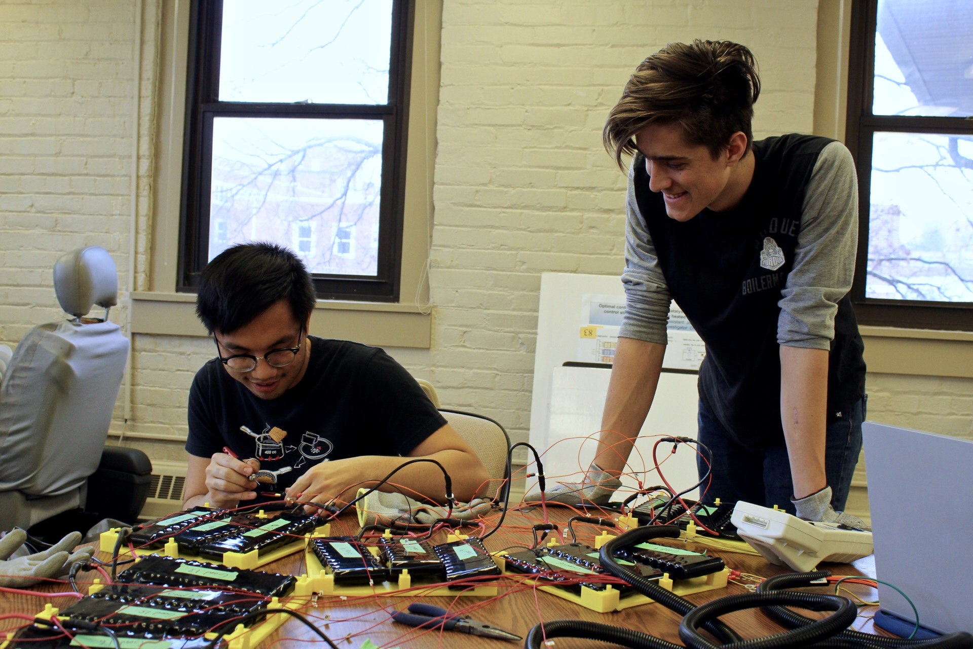 Emilio Sison and Nicholas Gildenhuys testing the battery management system (BMS).