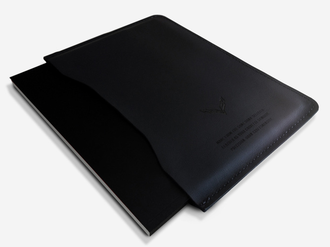 Mockup showing the book with the black leather sleeve.