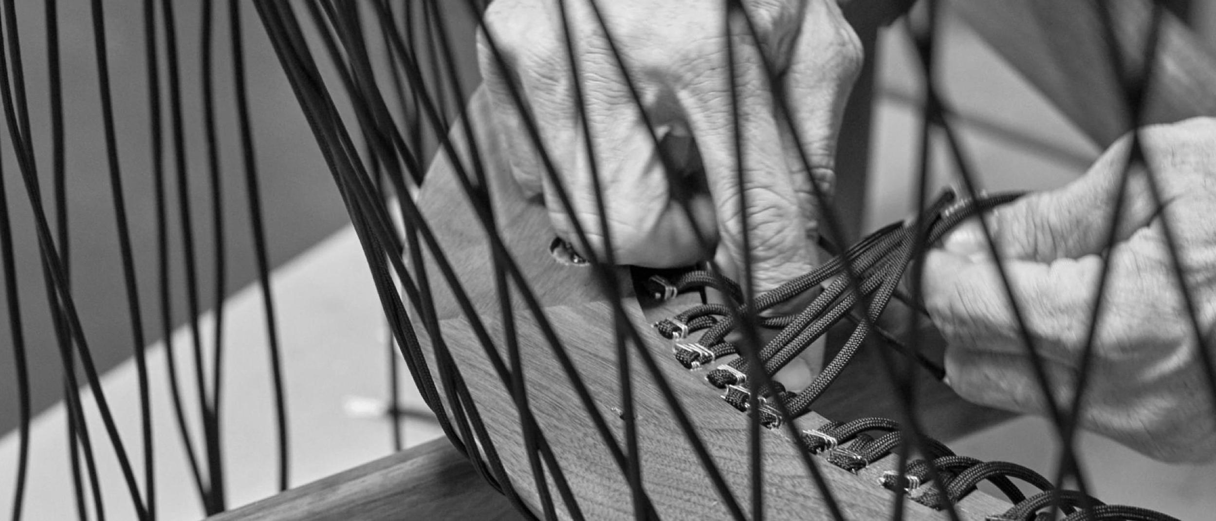 Hands assembling the Crosshatch back.