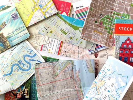 a pile of maps that I've been collecting over the years