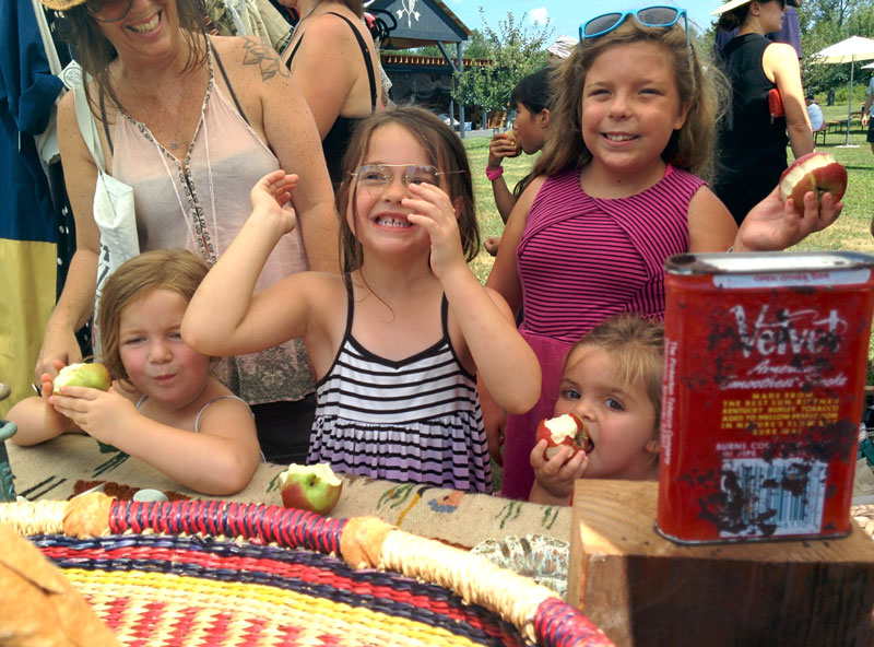 Seriously cute kids eating apples and trying on vintage eyewear at Westwind