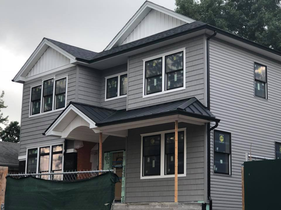 Vinyl Shake with siding and metal roof. Complemented by Board and Batten in the gables and Azek finishes.jpg