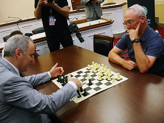 Rex Sinquefield (R) and Gary Kasparov (L) square off