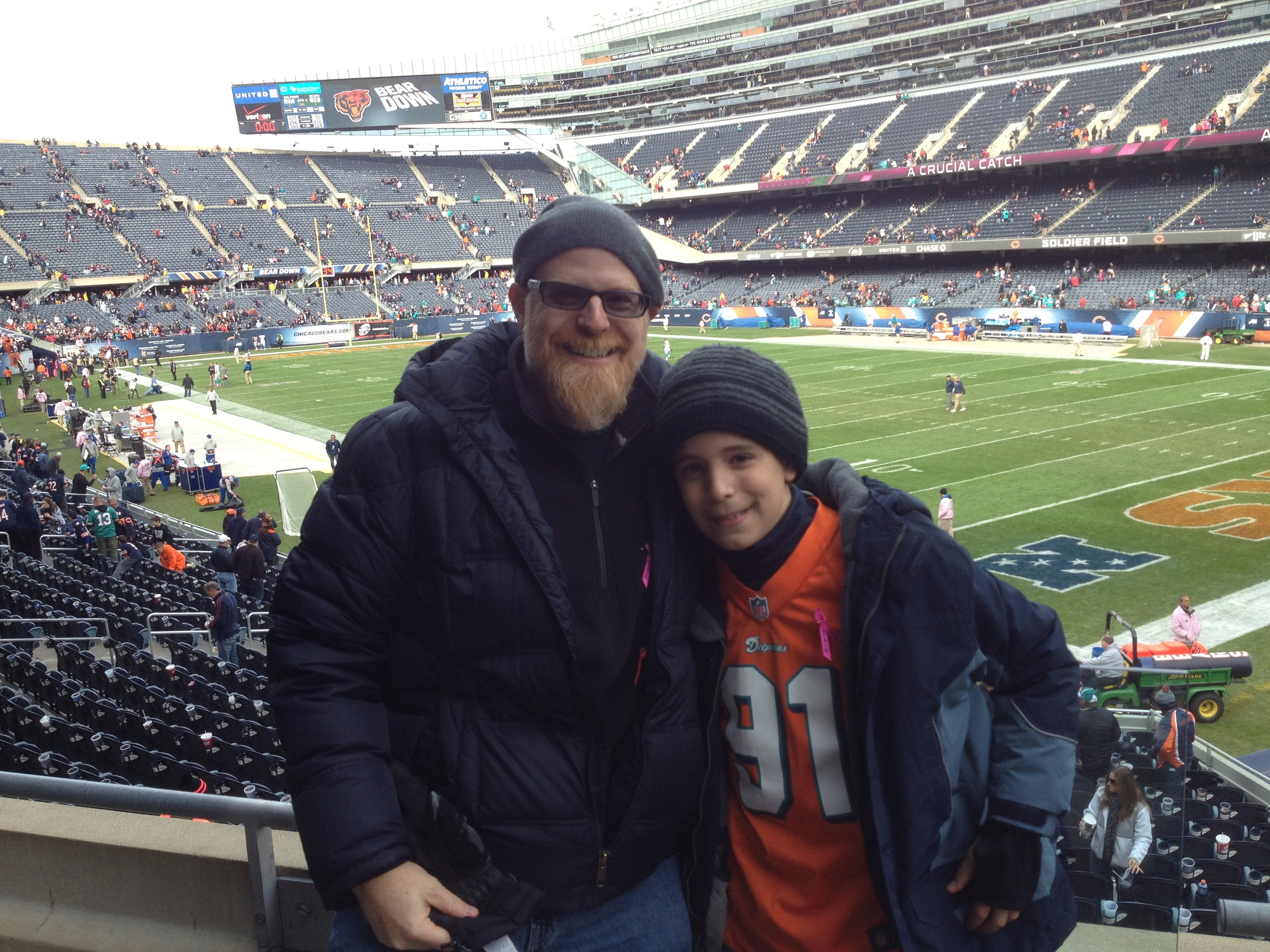 Professor Hurst, at a Dolphins game, with his son