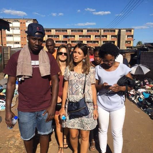 Alfa Bumhira ('16) leads fellow  exchange students on  a tour through Mbare Township, Zimbabwe