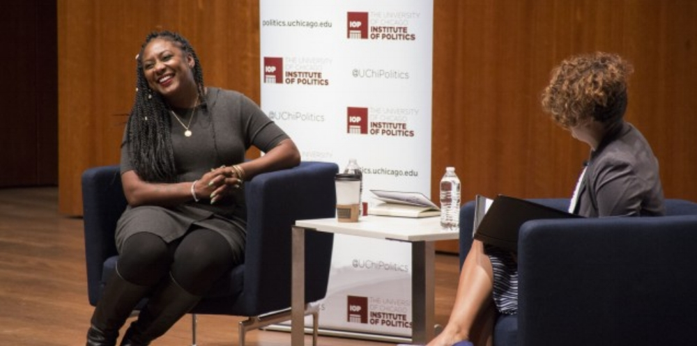 Alicia Garza (left), co-founder of the Black Lives Matter organization, and Eve Ewing (AB '08), a p  ostdoctoral scholar at the University of Chicago School of Social Service Administration, engage in a deep discussion hosted by the Institute of Politics.  Photo courtesy of the Institute of Politics