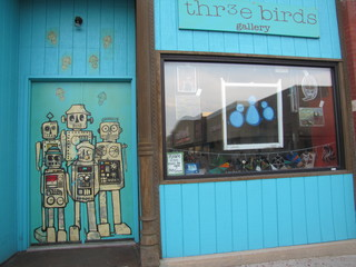 Adorable robots greet art-seeking patrons at Thr3e Birds Gallery. Photo courtesy of ArtSlant