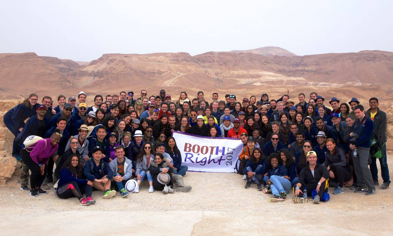 Boothies stop to take a cheery photo during a sunrise visit to Masada