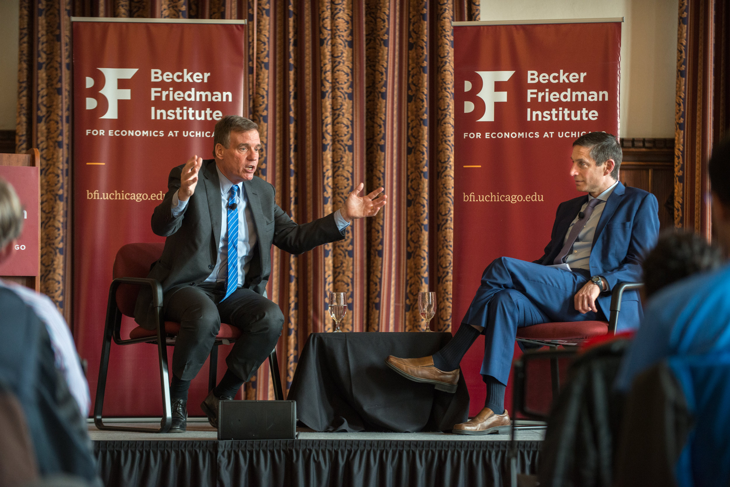 Sen. Warner (left) and BFI Director Michael Greenstone talk about the economy and the future.