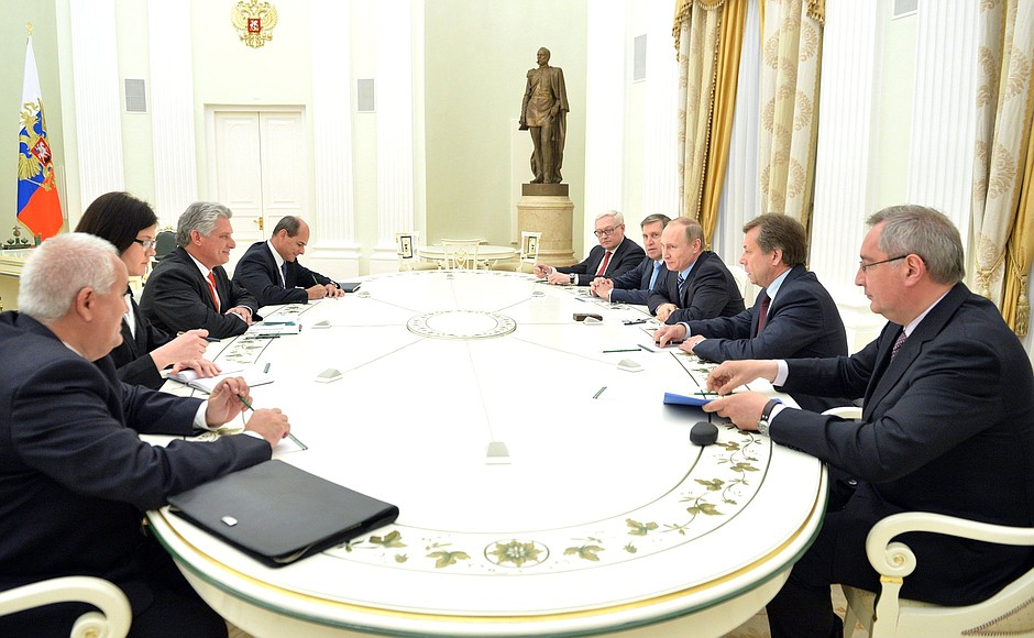 As First Vice President, Miguel Diaz-Canel (left) sits with Russian President Vladamir Putin discussing bilateral trade and economic cooperation.