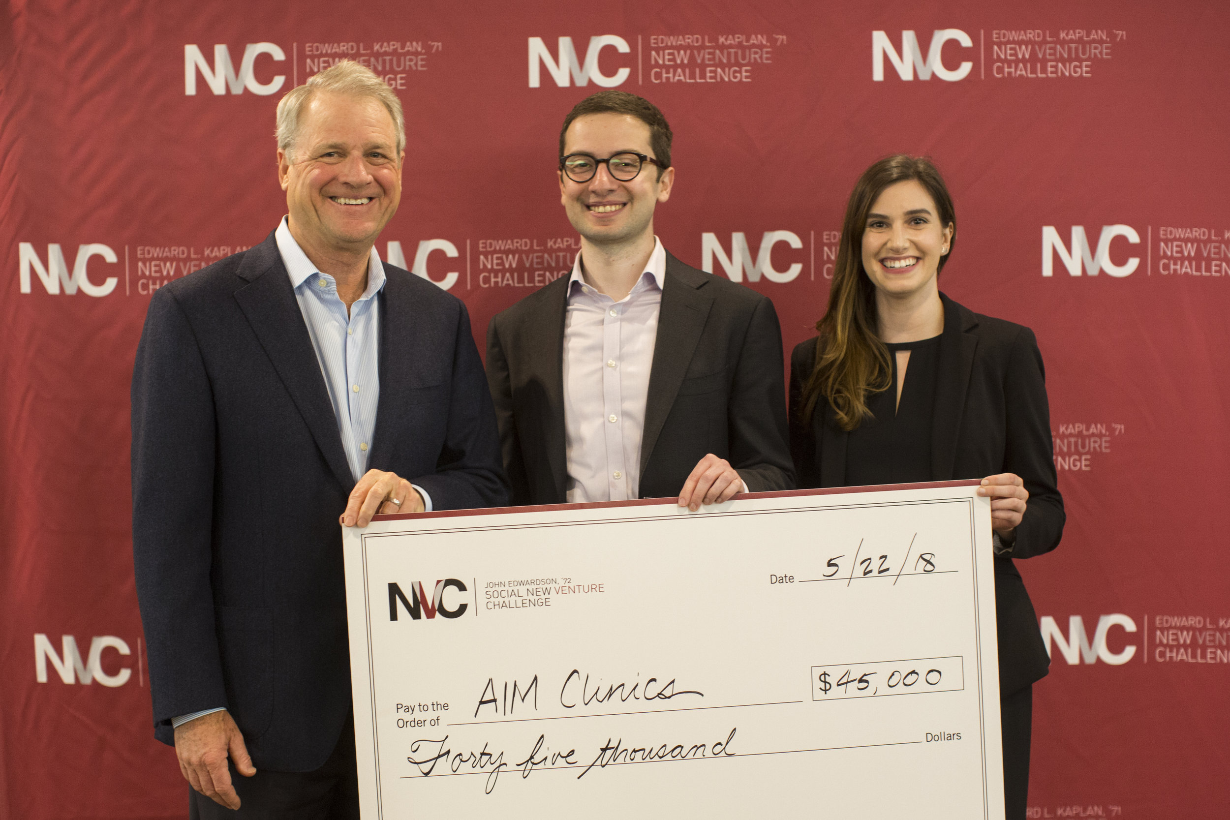 Left to right: John Edwardson, '72, retired CEO and chairman of CDW and title sponsor of the SNVC, with SNVC winners George Boghos and Frankie Schiller