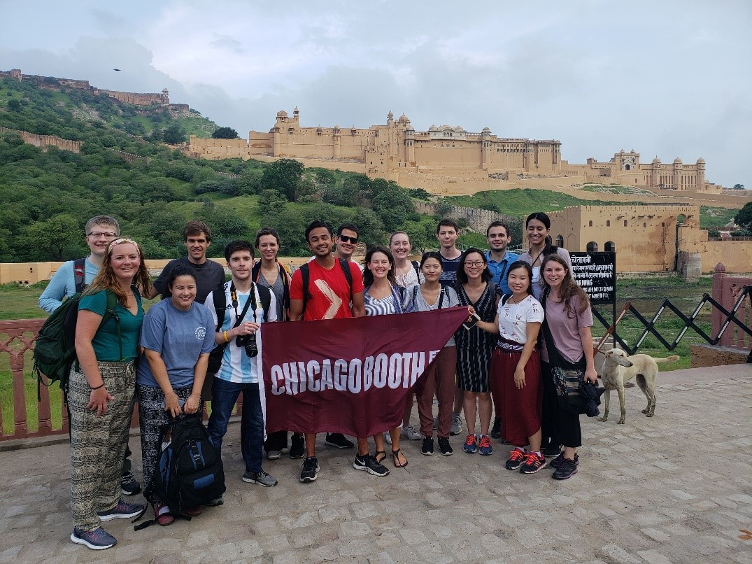The group, photobombed by a dog in Jaipur, with Amer Fort looking on in the background.