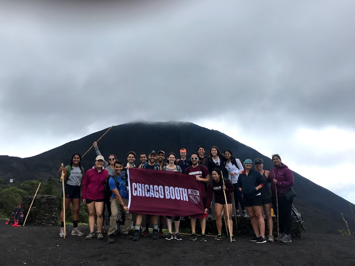Casually posing by a volcano, NBD. Random Walk Guatemala keeps their cool, waving the Booth flag in front of a mountain that would later roast marshmallows.