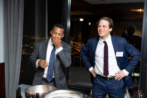 Elliot Thomas reacts to the grog with Ben Jacobson, both AFG members and Class of 2020