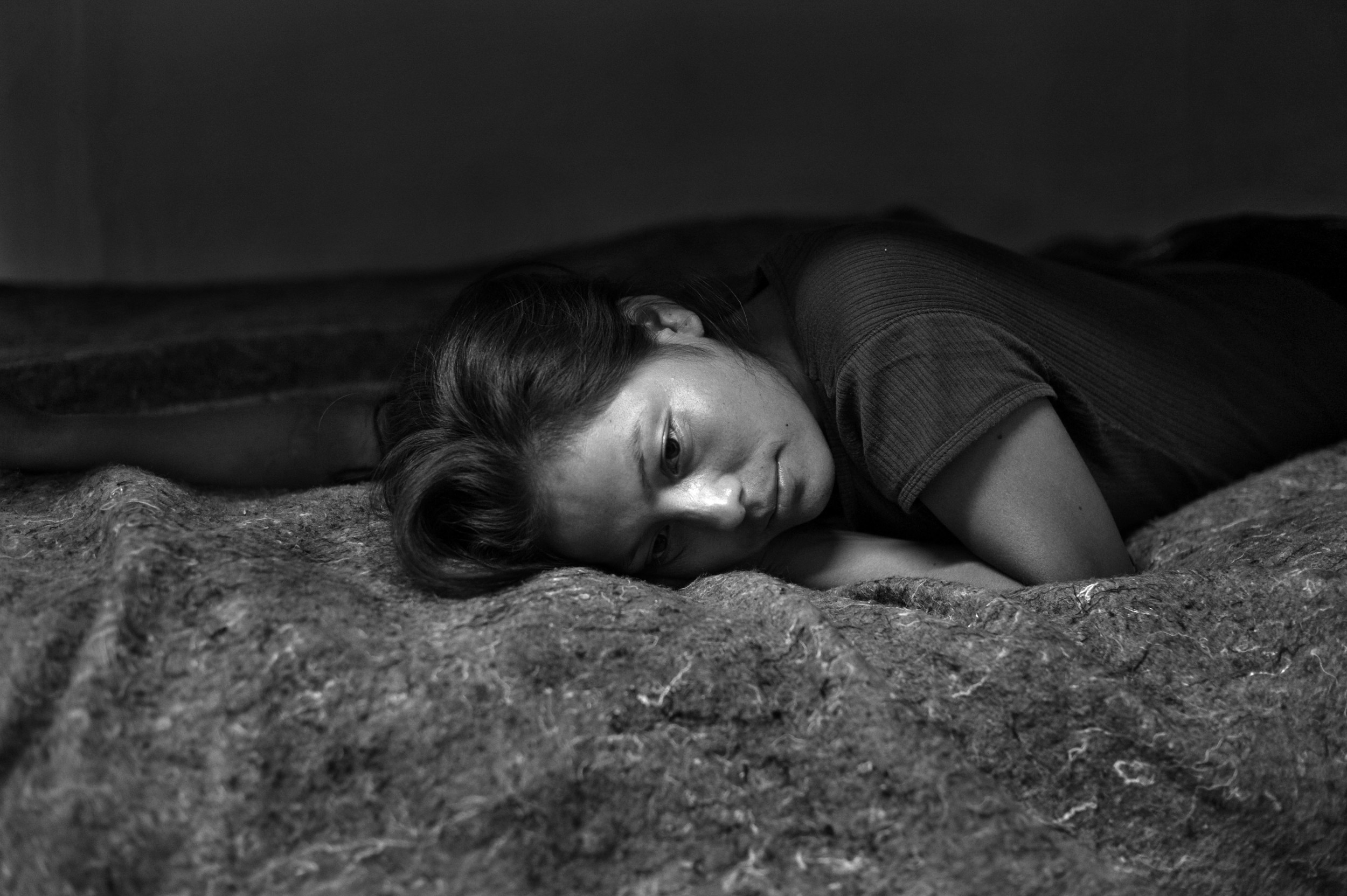 MARISOL ESPINOZA, a 20-year-old woman from Chiapas, Mexico rests in a shelter for deportees and migrants the night after she was deported from the US. She crossed into the United States and walked through the Arizona desert for 6-days until she was arrested by the U.S. Border Patrol.July 28, 2012 ©Louie Palu/ZUMAPRESS.com
