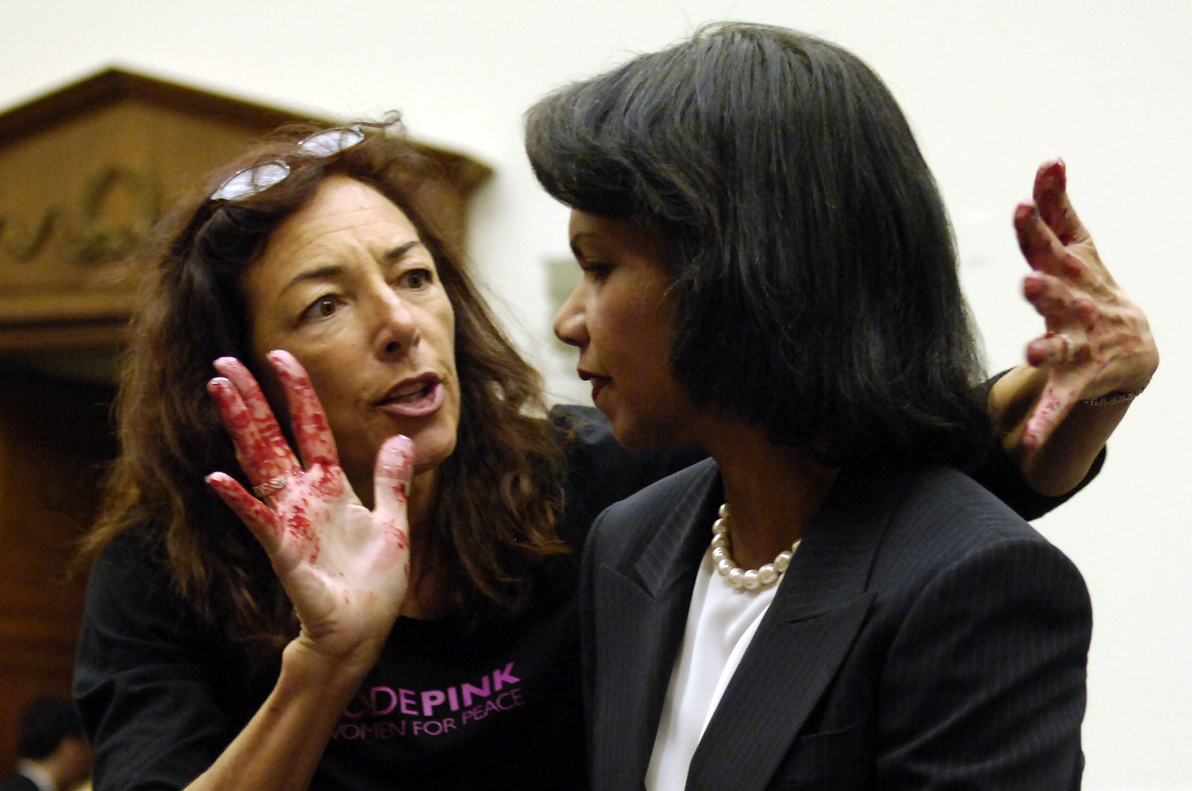 US Secretary of State Condoleeza Rice is accosted by Code Pink protester Desiree Farooz who had simulated blood on her hands just before the Secretary was to give Testimony on the U.S. Middle East Policy before the House Foreign Affairs Committee.Oct 24, 2007 ©Louie Palu/ZUMAPRESS.com