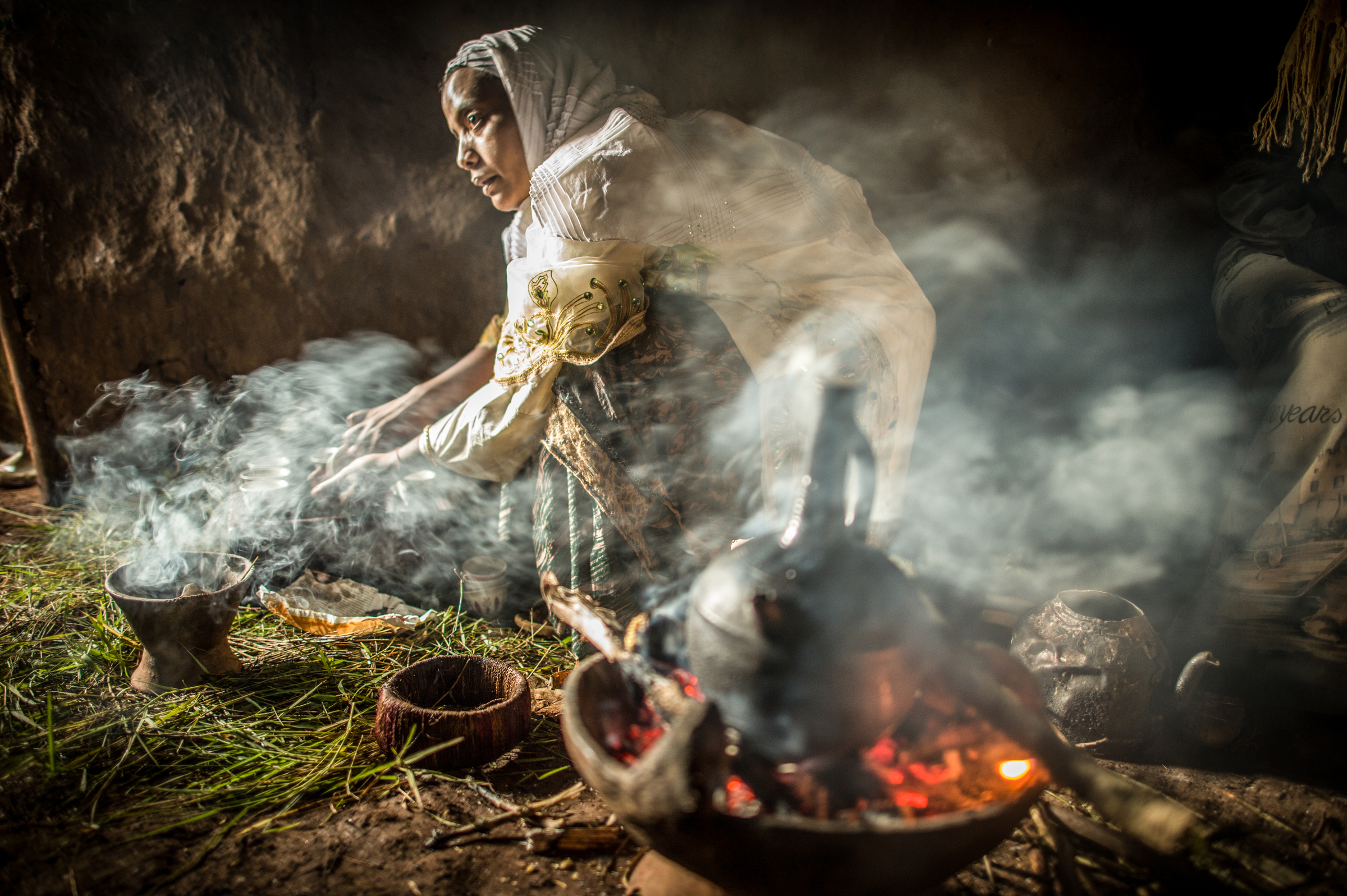 Ramla Sharif  roasts coffee inside her home in the village of Choche in Ethiopia. Legend has it this is the birthplace of coffee. The region is home to the largest pool of genetic diversity in the world of coffee. It is home to more genetic diversity in coffee than the rest of the producing countries combined by a huge margin. 2012  © Ami Vitale