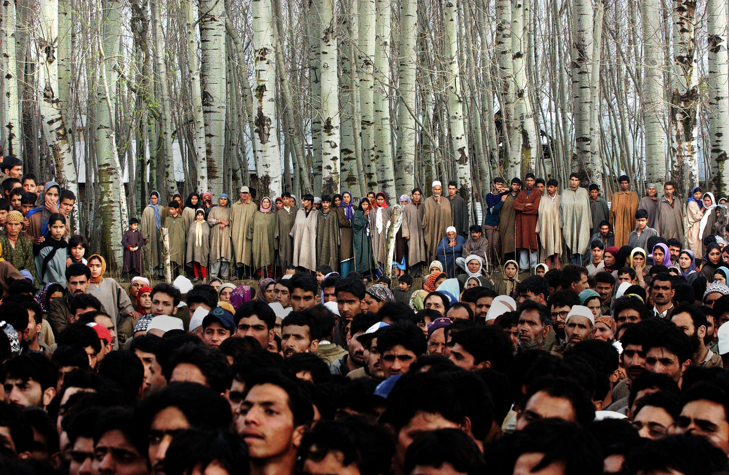 Villagers mourn the death of five people who were killed along with  48 who were injured, when a grenade exploded in the hands of a man who was seeking to extort money from a family in the Badgam district of Kashmir. 2004   © Ami Vitale