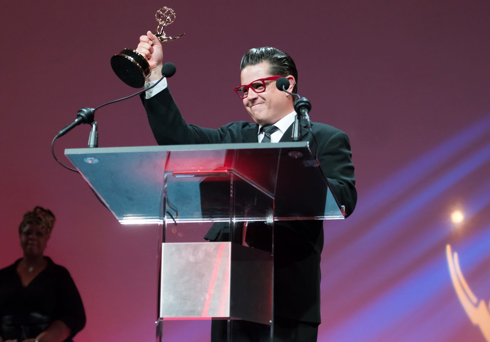 Mike Kepka accepting one of his four Emmys. © Richard Lau