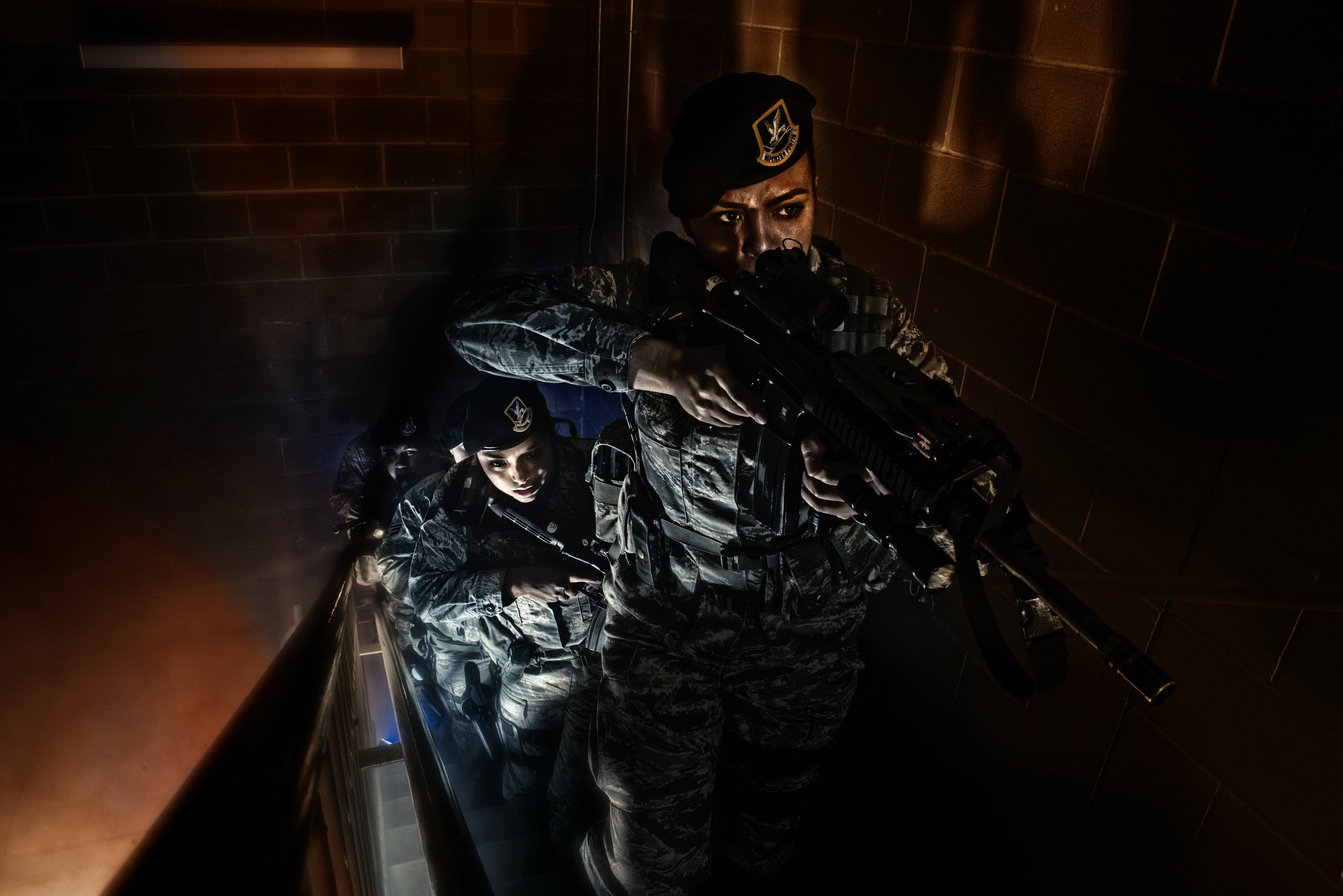 An Air Force Security Forces squad clear the stairwell of a training building during a simulated hostage situation in San Antonio, Texas. 2013 © Stacy L. Pearsall