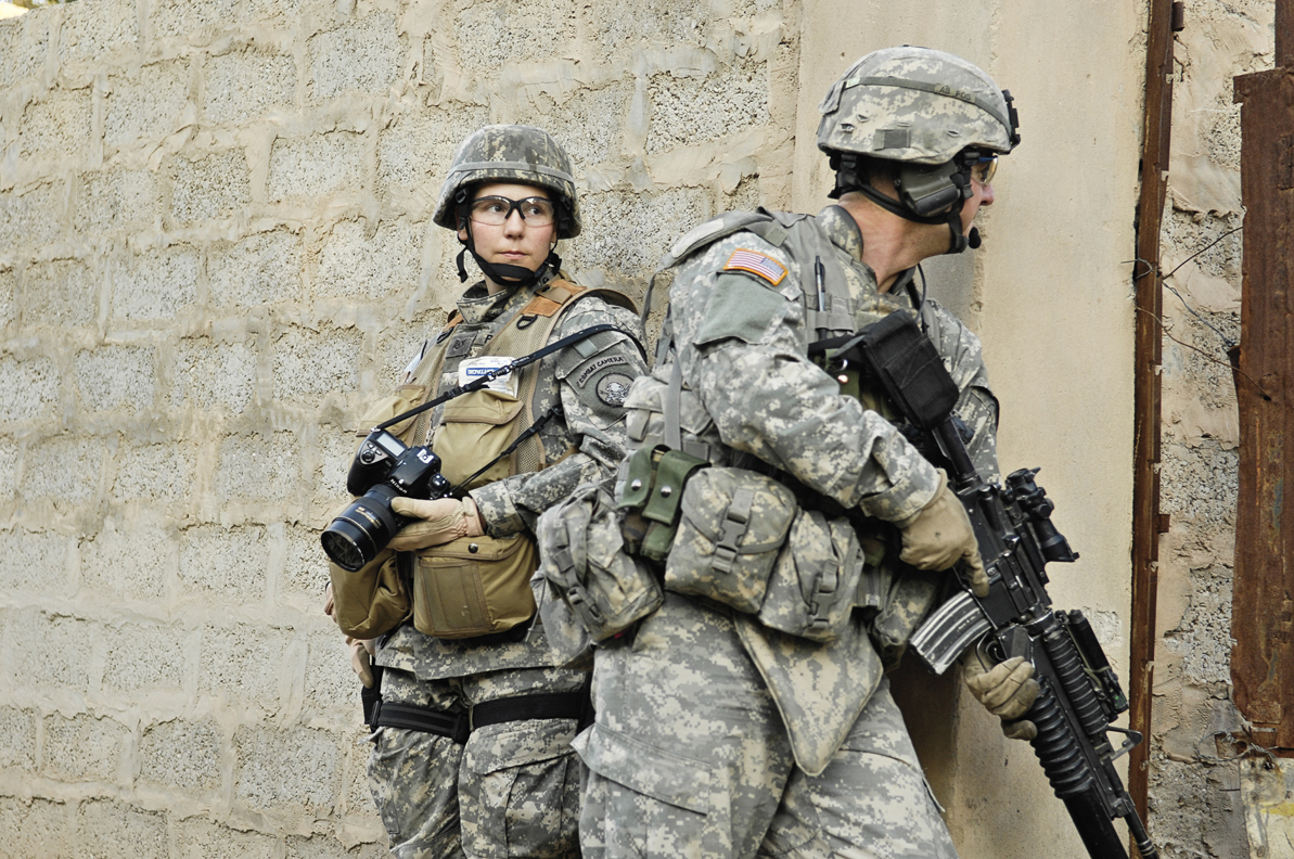 Staff Sergeant Stacy Pearsall documents combat operations with the 1st Cavalry Division, 12th Infantry Regiment, in Khalis, Iraq. 2007. Photo by Andy Dunaway