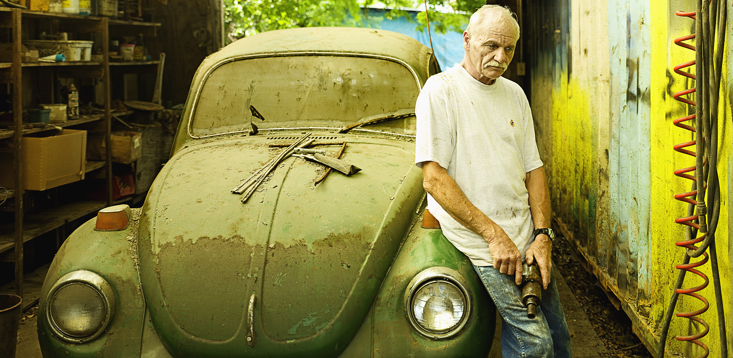 After Katrina: Mark Hounan and his VW Beetle  © Stephen Wilkes