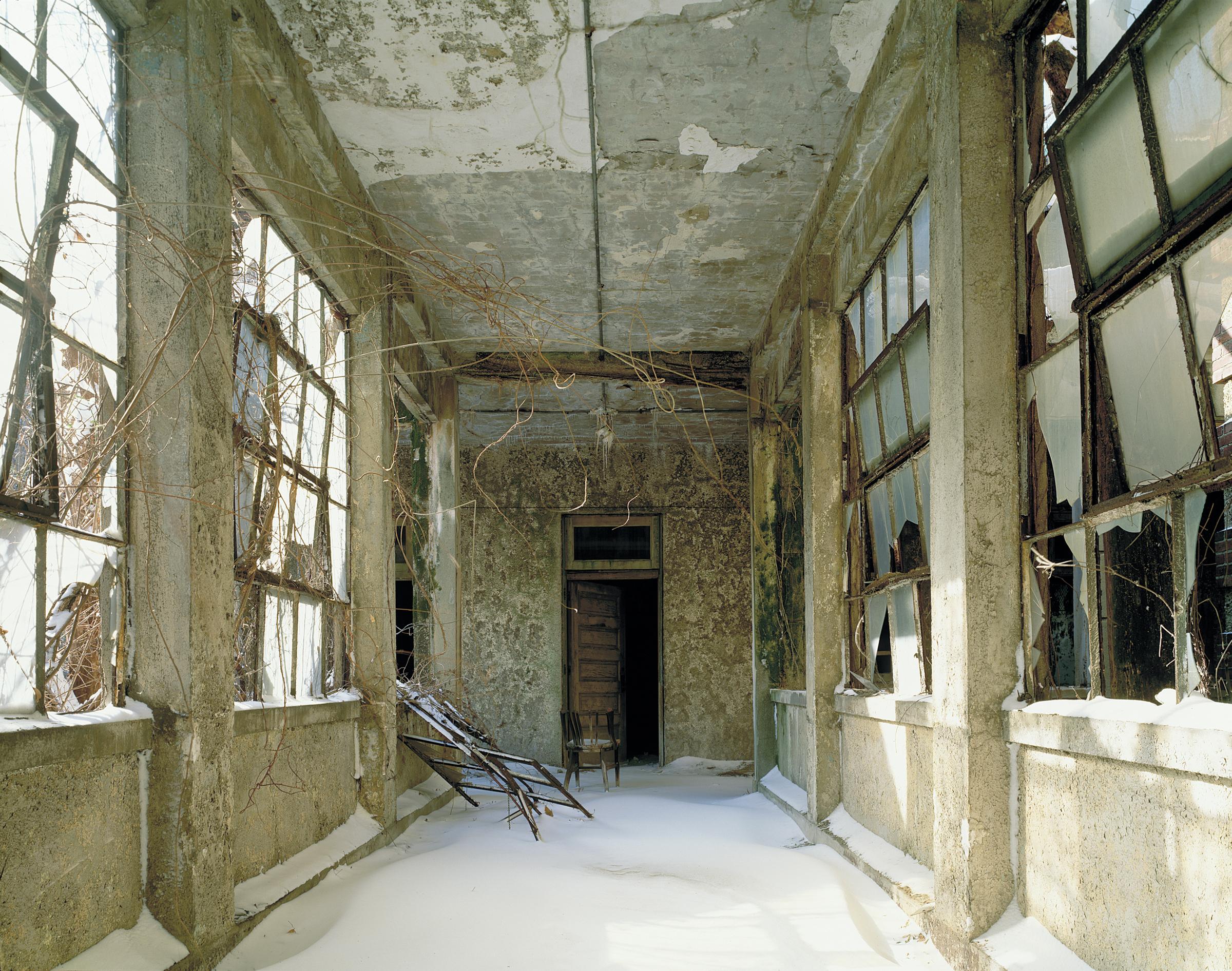 Ellis Island: Snow-covered corridor, Island 3   © Stephen Wilkes