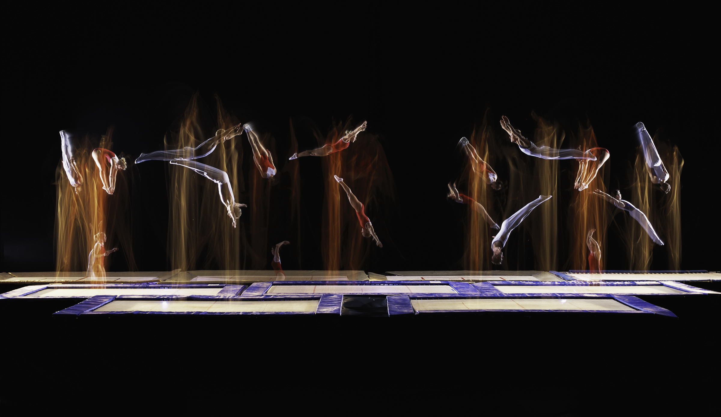 New to the 2000 Olympics, competitors perform compulsory routines on the trampoline. Lubbock, Texas Sports Illustrated 2000 © Joe McNally