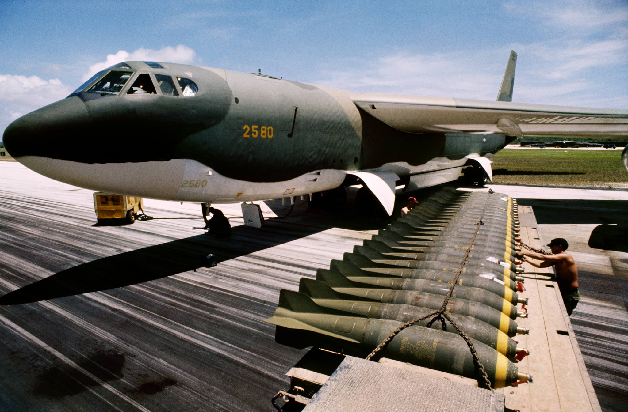 A member of US Air Force loads bombs onto a B-52 at Anderson Air Force Base in Guam in preparation for bombing missions over Vietnam during Operation Arc Light. June, 1972 © Jean-Pierre Laffont