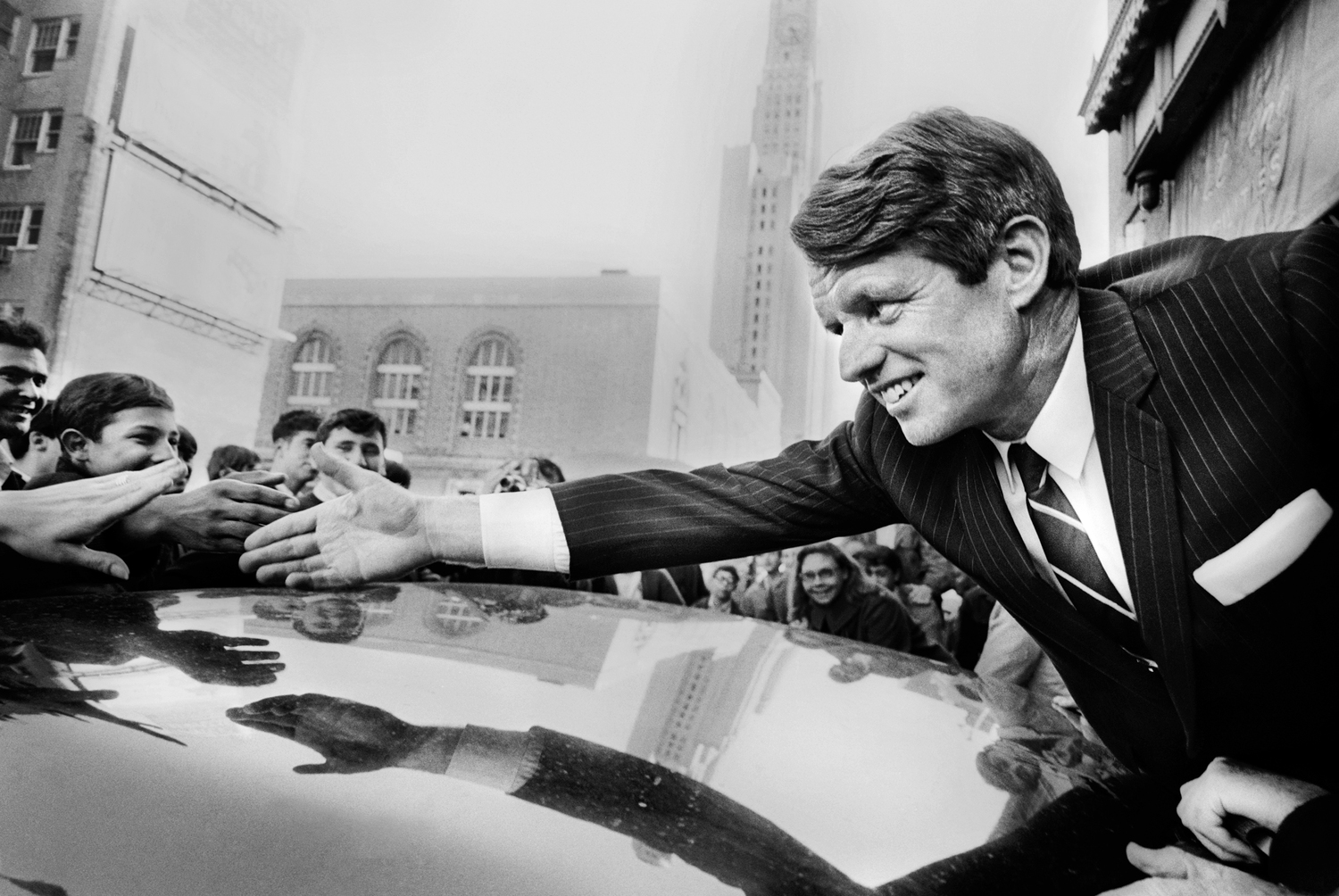 Robert Kennedy, Democratic Senator from New York, greets his supporters at Fort Greene, NY during his campaign for president. December 1, 1967  © Jean-Pierre Laffont