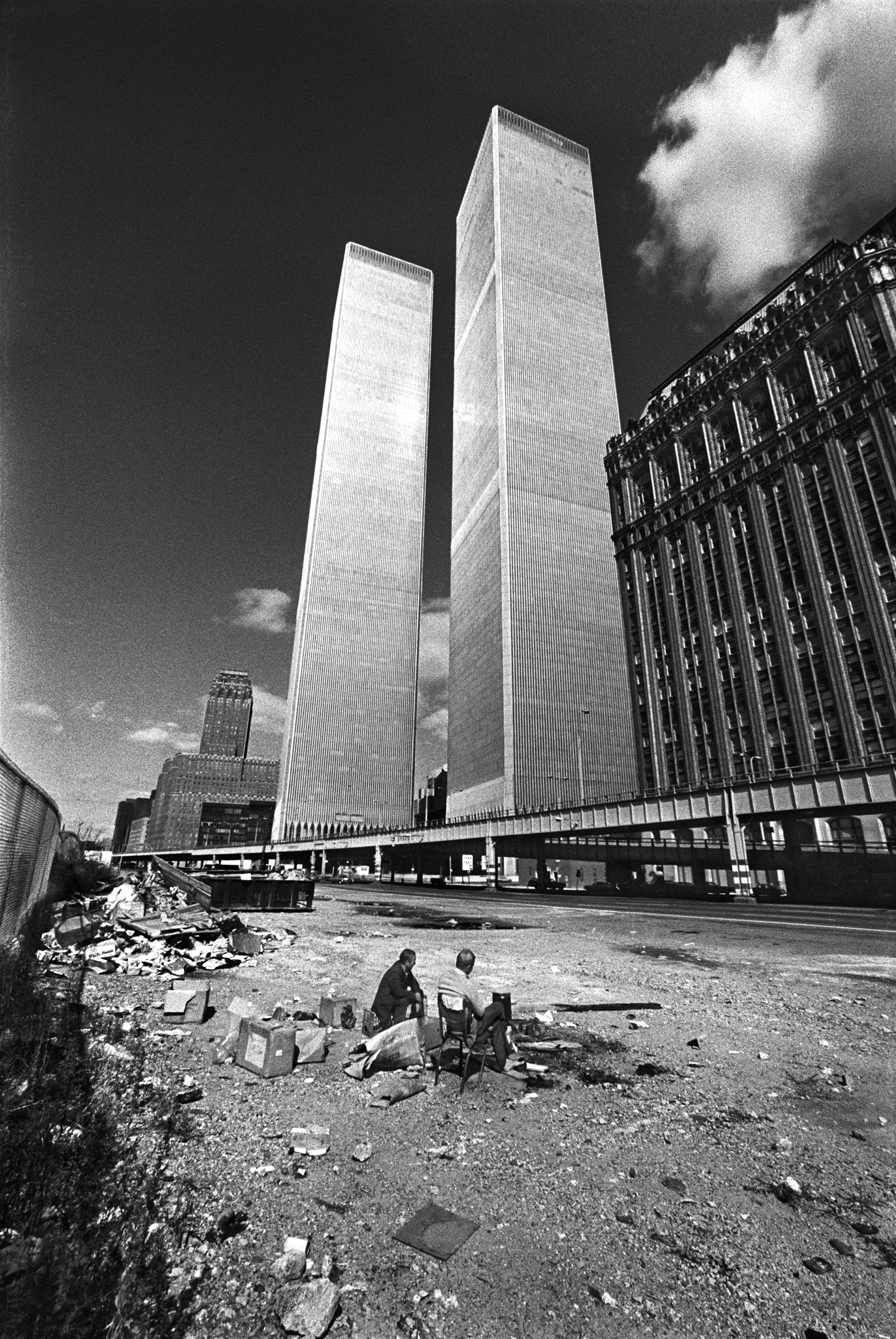 Two homeless men squat below the recently constructed World Trade Center. New York City was bankrupt, in shambles and the building was not occupied.  October, 1975  © Jean-Pierre Laffont