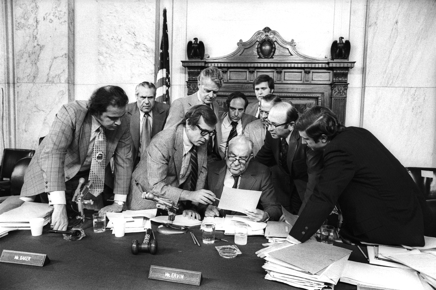 The Watergate Hearings: (l to r) Fred Thompson, Howard Baker, Edward Gurney, Sam Erwin (seated center) Samuel Dash, and unidentified) in discussion.  August 9, 1974  © Jean-Pierre Laffont