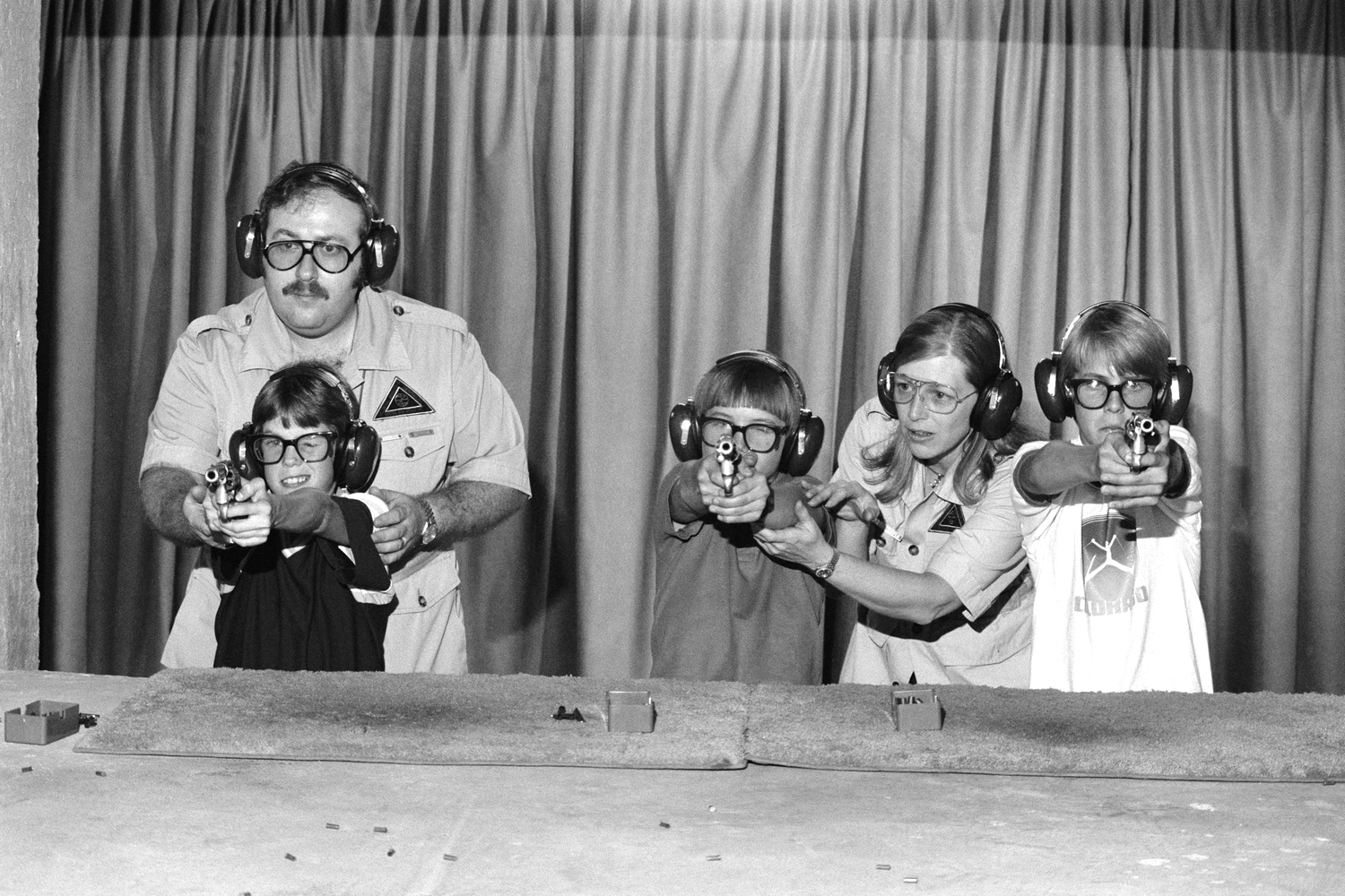 Children are taught how to handle firearms at a special school in College Station, TX, created by retired colonel Sid Loveless. June 1981 © Jean-Pierre Laffont