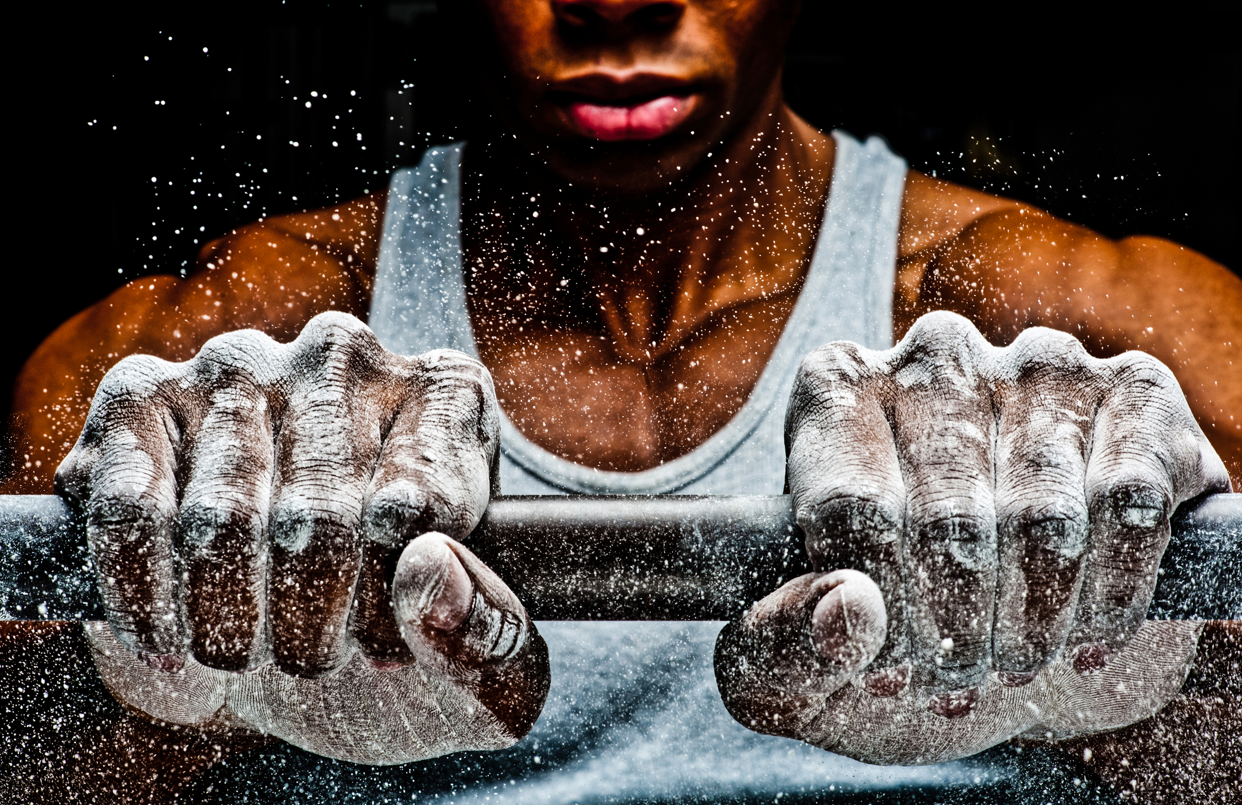 Chalk covers the hands of a body builder © Rob Hammer