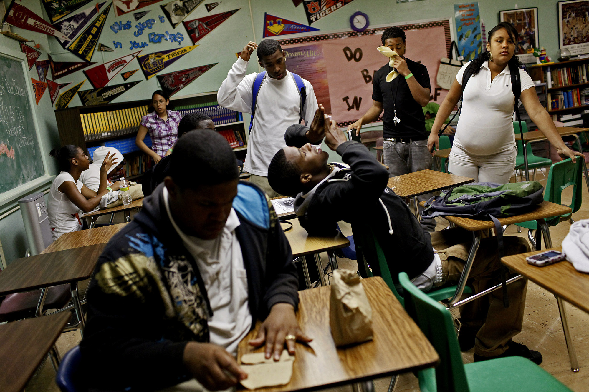 Milli Zepeda, 17, almost nine months pregnant, waits with her class for instructions on where to go from a substitute teacher at Sam Houston High School.  ©Lisa Krantz/San Antonio Express-News/ZUMA Press